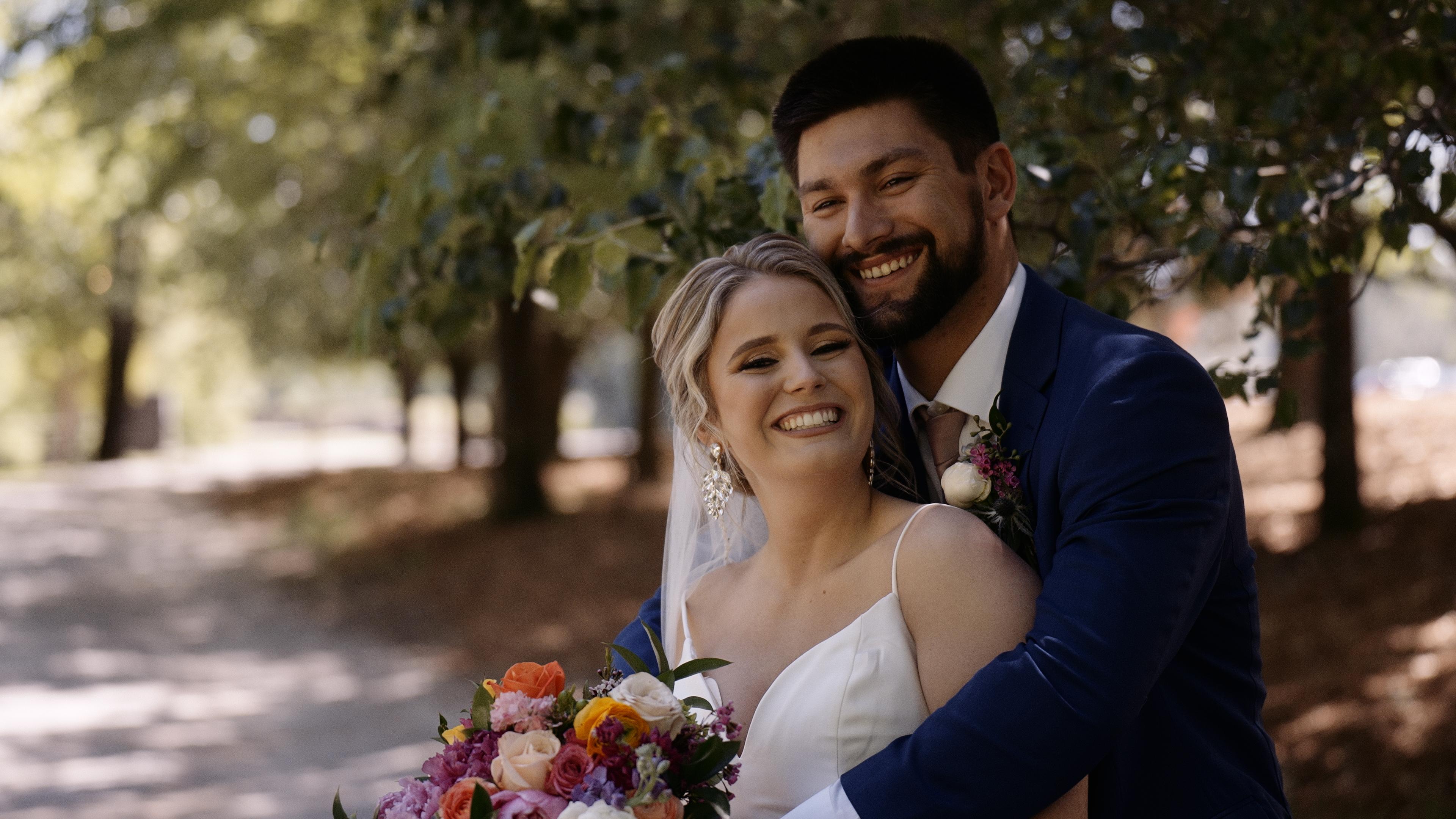 Couple at fun Alabama barn wedding