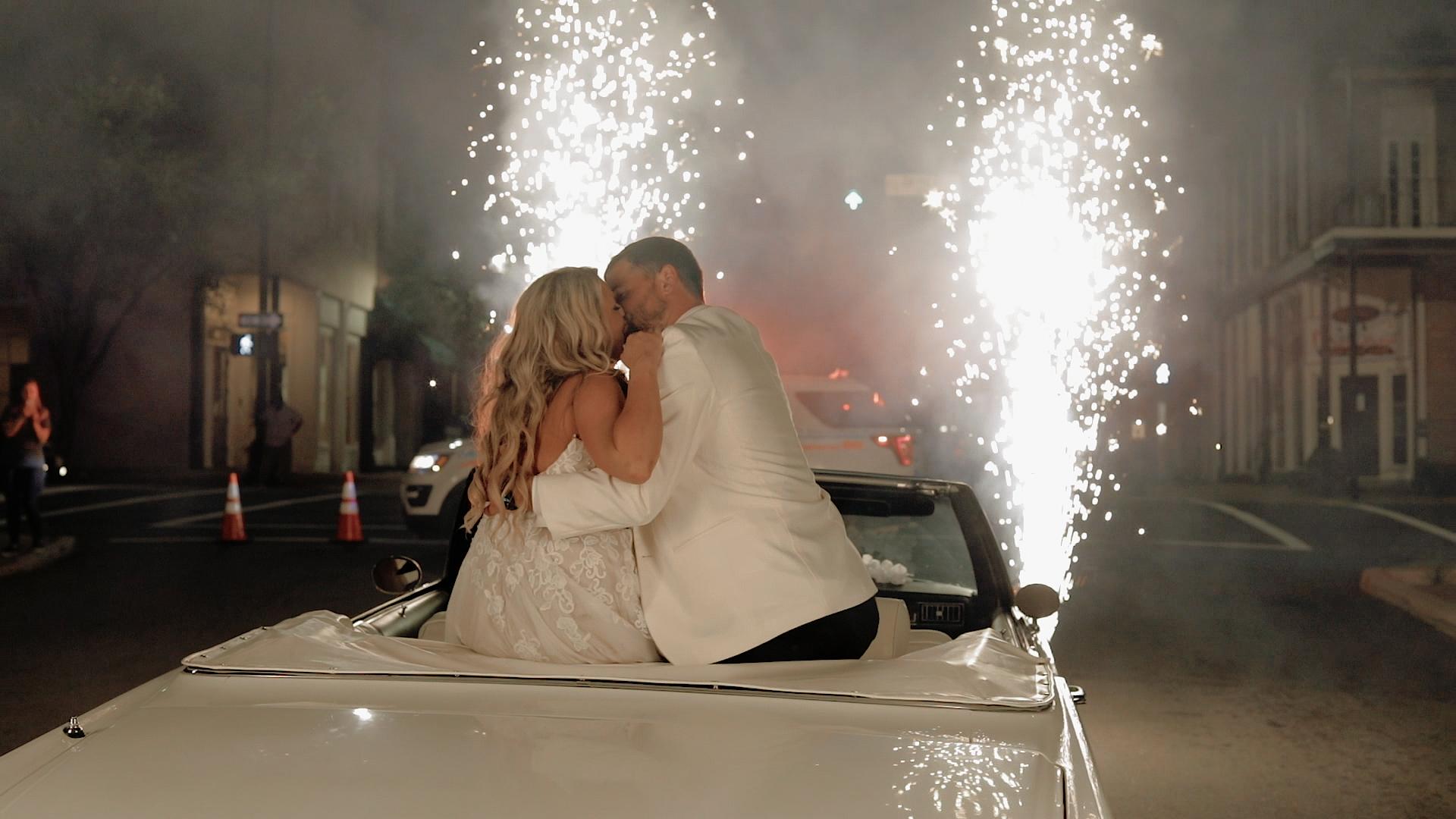 Couple doing sparkler exit at Catholic, glam Shreveport wedding