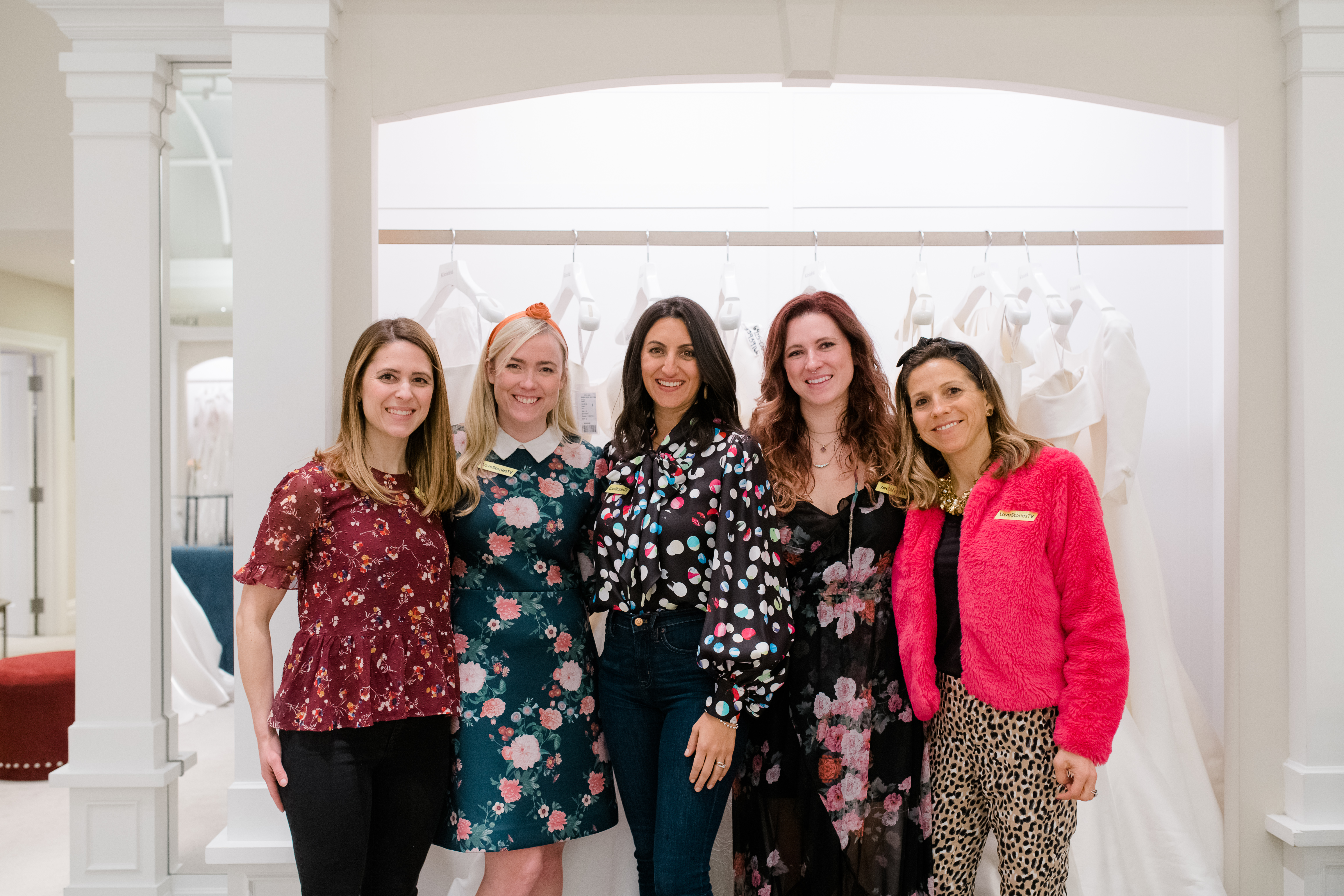 Five professional woman at Kleinfeld Bridal wedding event by Love Stories TV