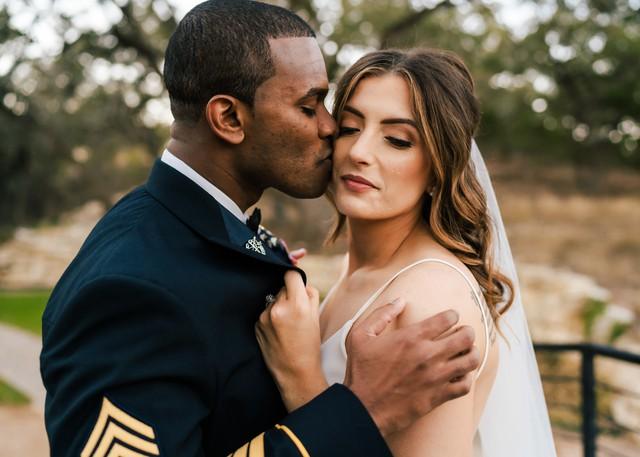 Groom kissing bride on wedding day