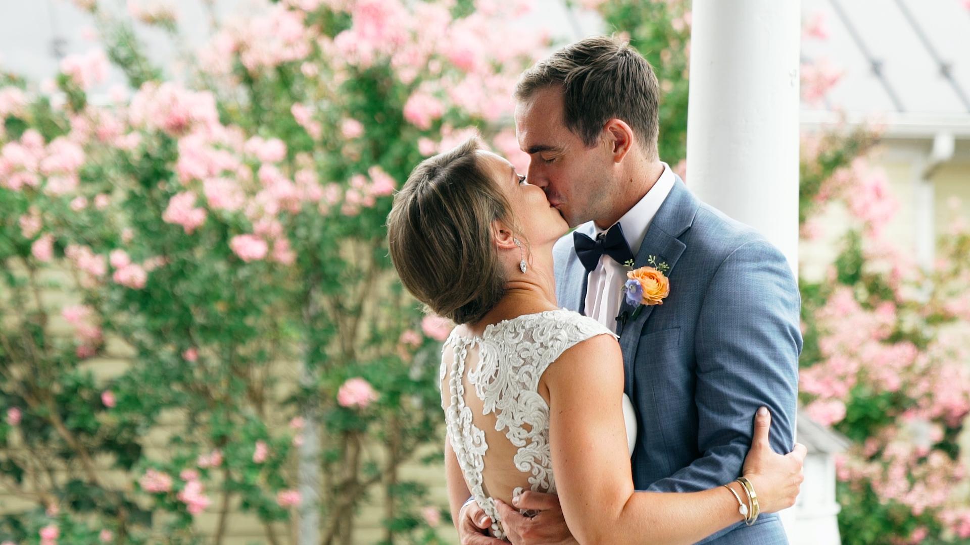 Bride and Groom kissing in garden