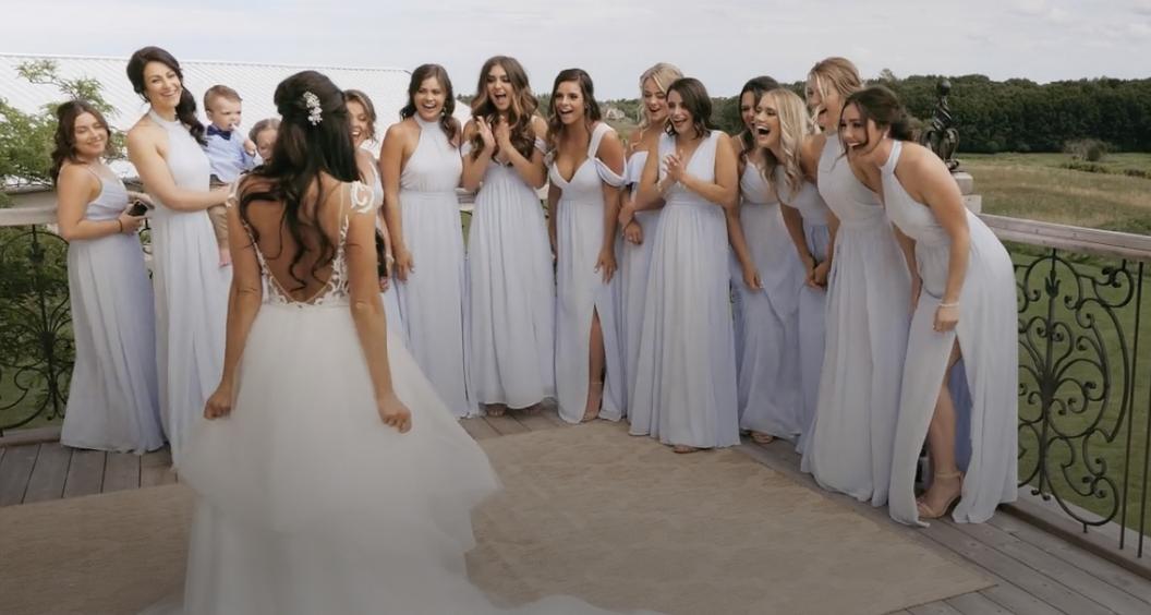 Bridesmaid first look to bride's wedding dress