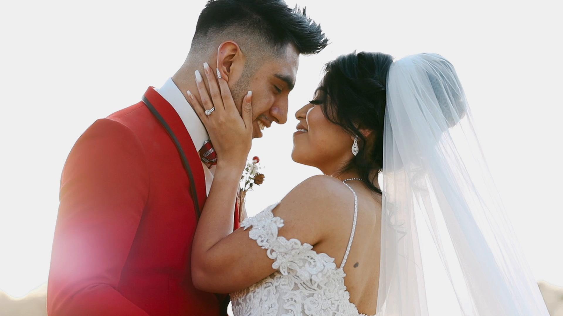 Couple embracing in fun, boho Mexican wedding