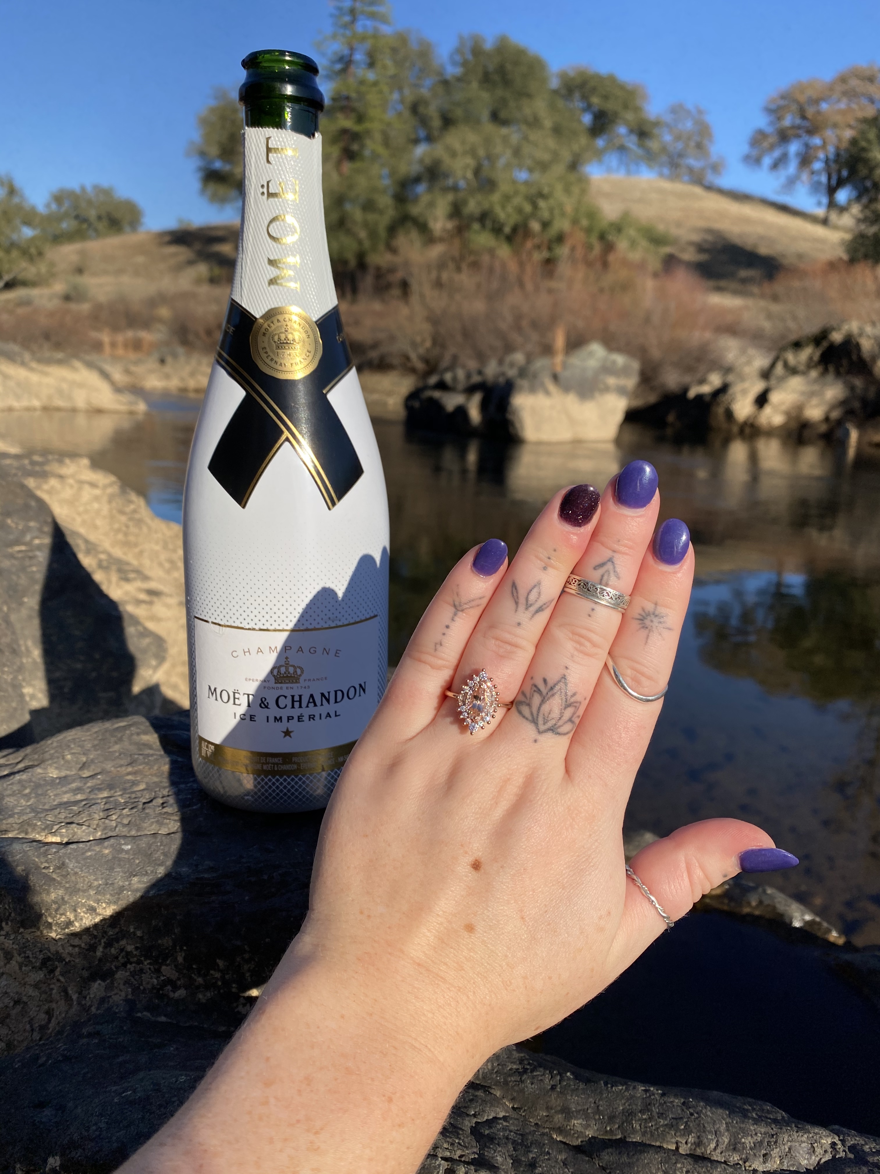 Morganite marquis engagement ring with champagne bottle