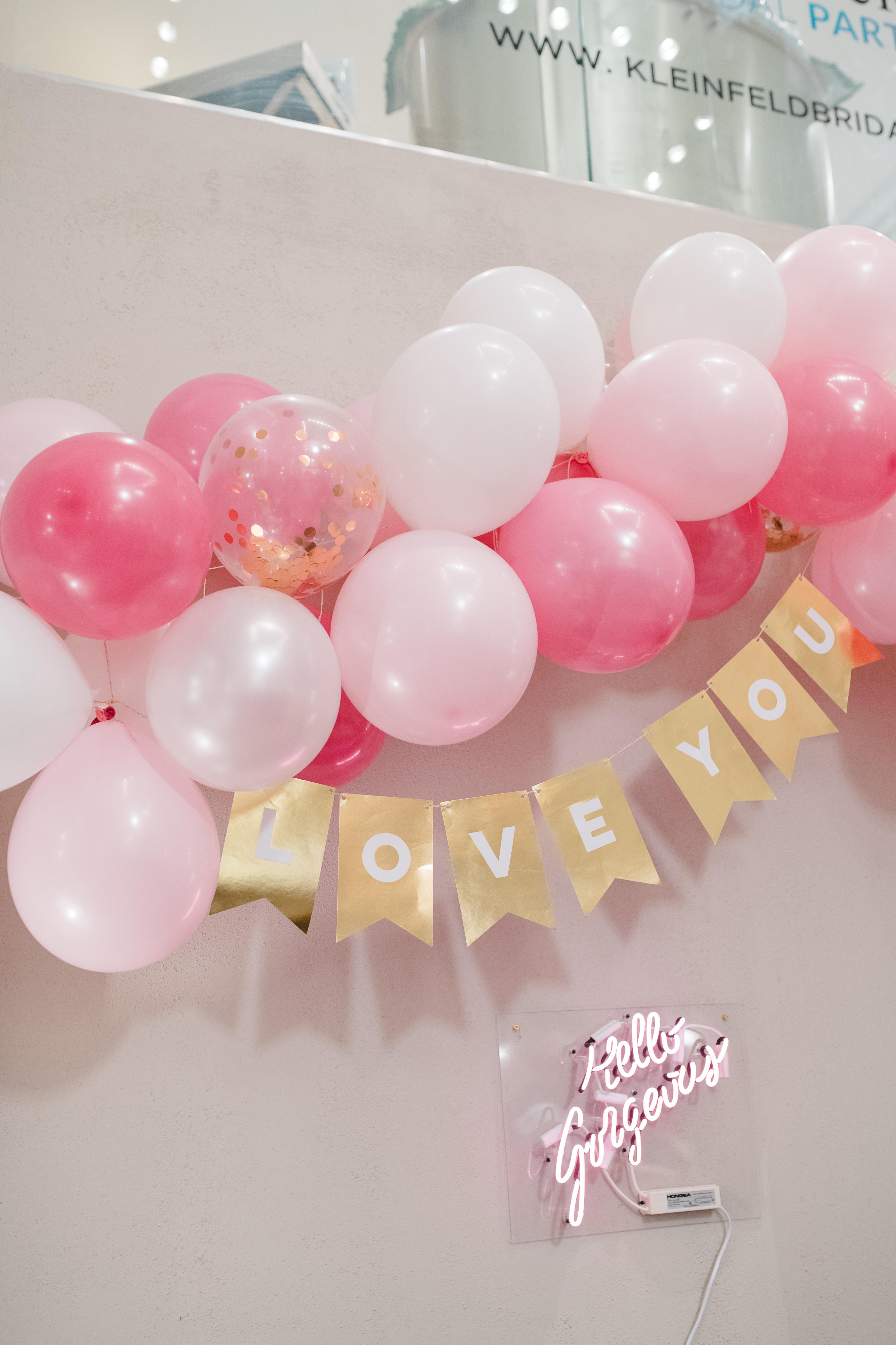 Wedding party balloon décor with neon sign