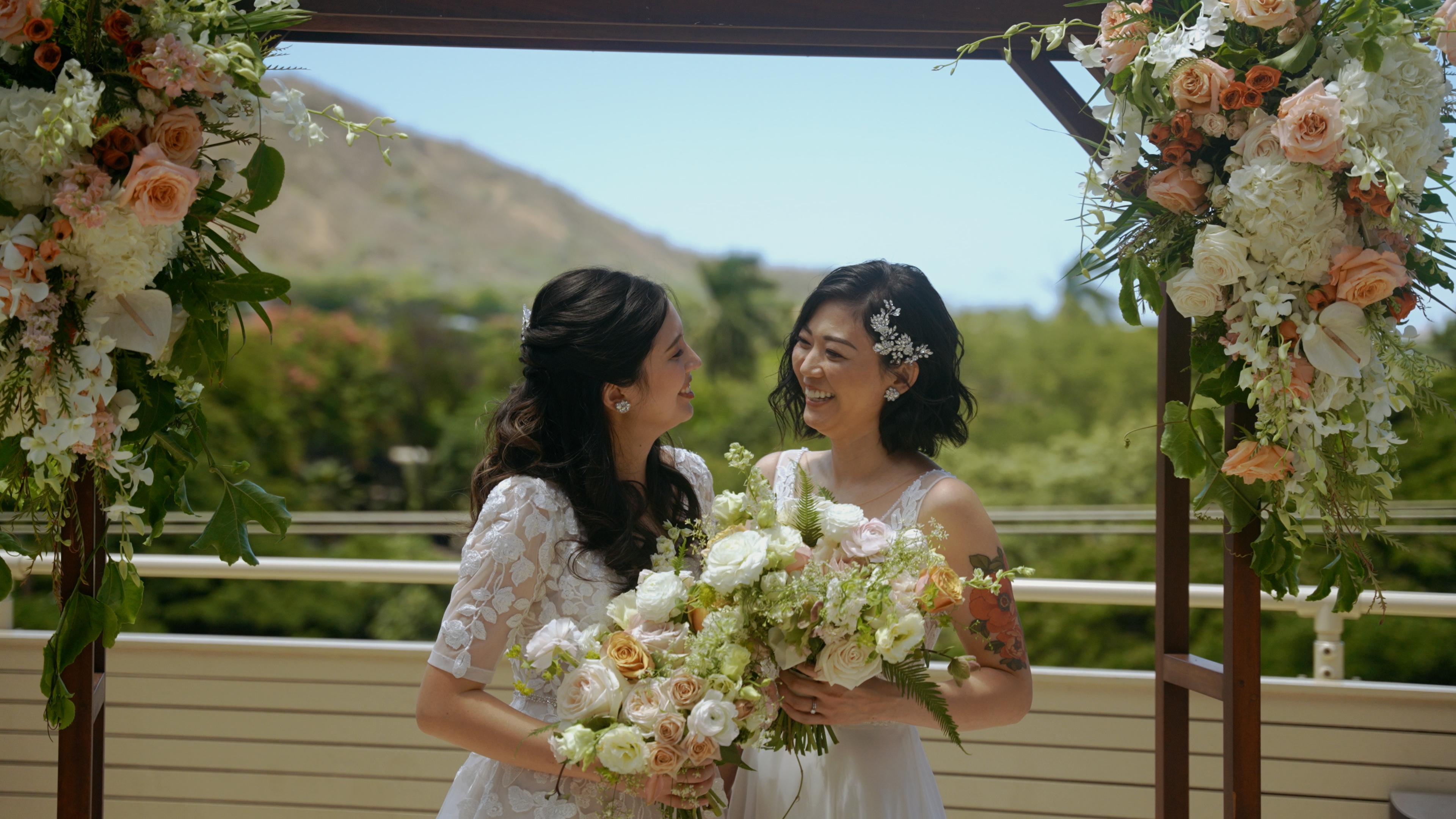 Lesbian couple at outdoor Hawaii hotel wedding