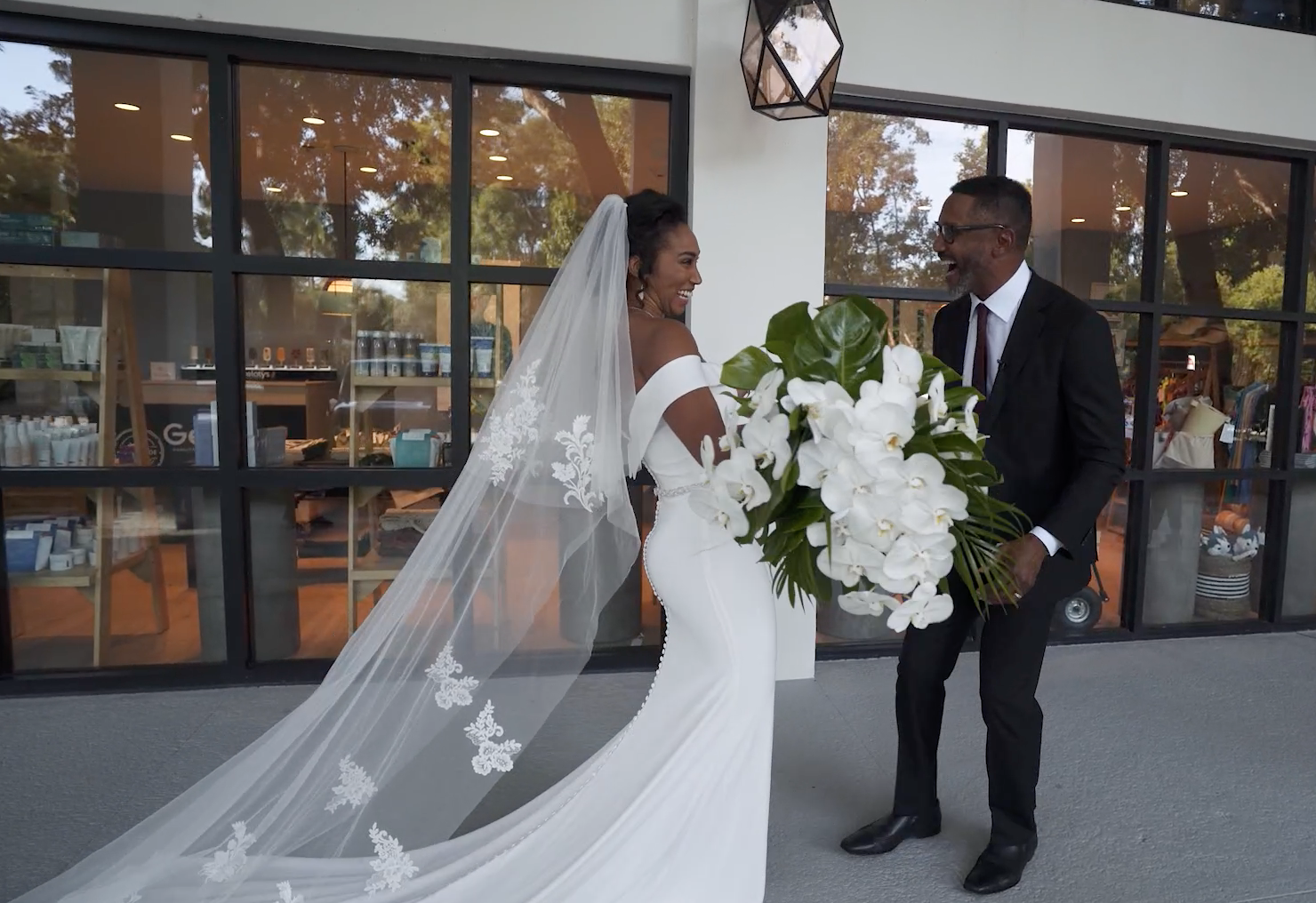 Bride and groom seeing each other for first time on wedding day