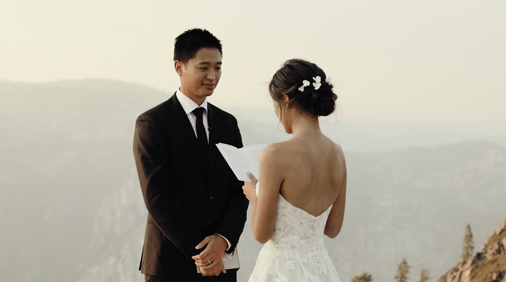 Couple exchanging vows in intimate, California mountain elopement