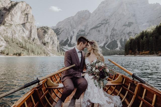 Austrian couple on boat in mountain elopement