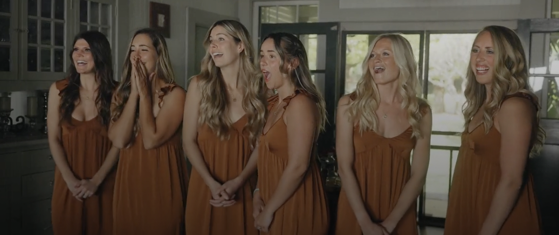Bridesmaids shocked by their first look at bride