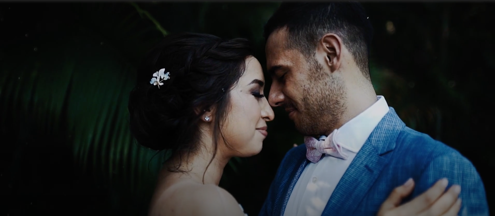 Mexican couple embracing at wedding